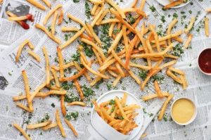 herb-seasoned-french-fries-on-newspaper-background-casual-summer-recipe1